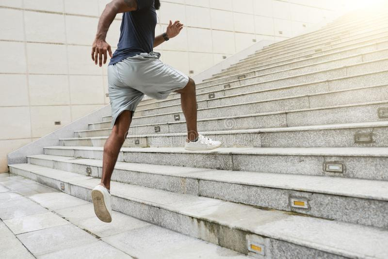 Athlete running alone stock photography