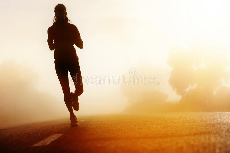 Athlete running road silhouette royalty free stock photo