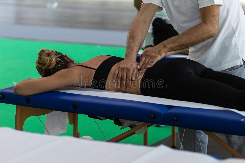 Athlete`s Back Massage after Fitness Activity; Wellness and Sport stock photo