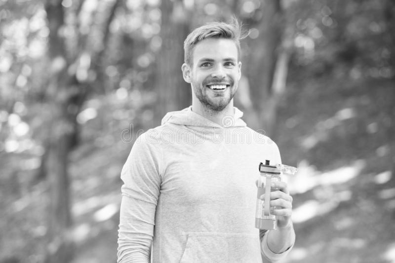 Athlete satisfied face hold bottle care hydration body after workout. Refreshing vitamin drink after great workout. Man. Athletic appearance holds water bottle stock photos