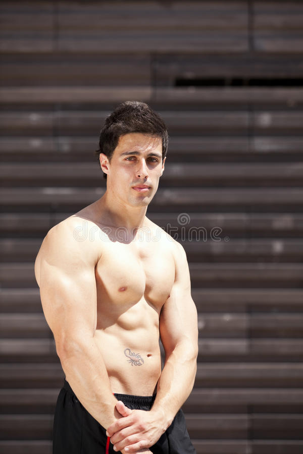 Athlete showing his muscles stock photo