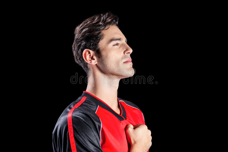 Athlete showing respect during national anthem. On black background royalty free stock photo