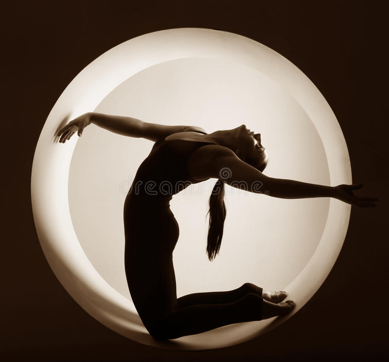 Athlete silhouette. In a circle royalty free stock image