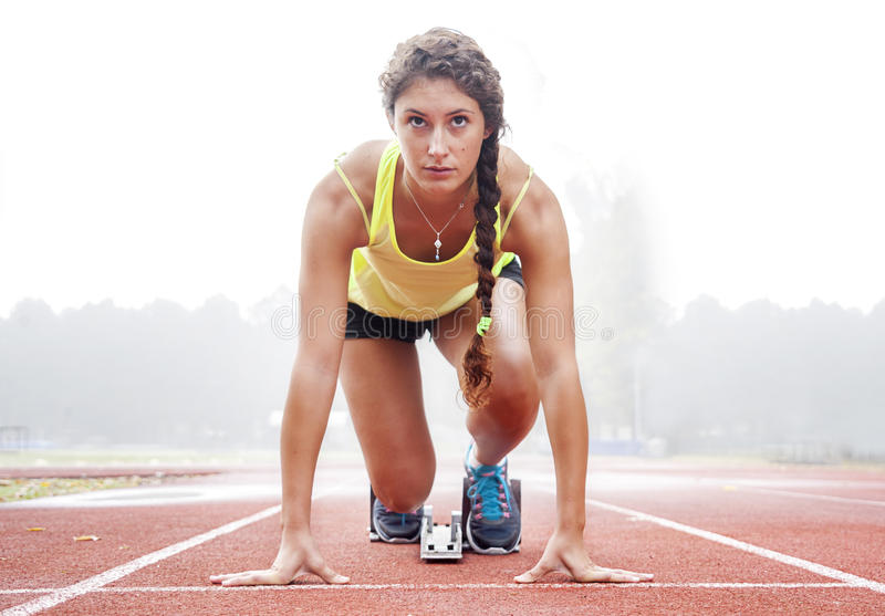 Athlete on the starting blocks stock photography