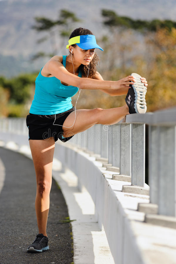 Athlete stretching royalty free stock photo