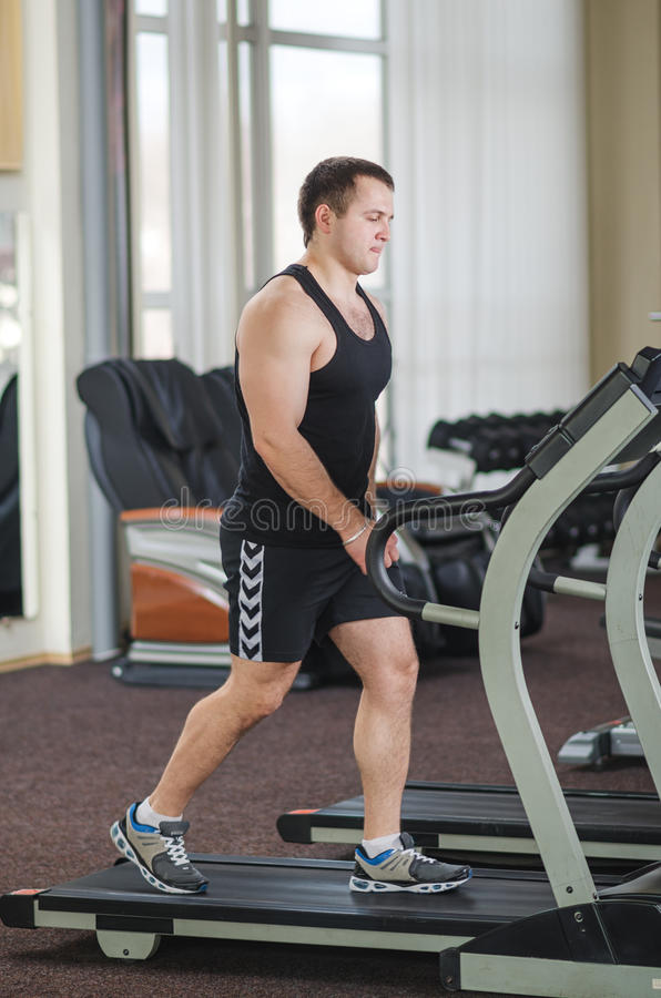 Athlete on the treadmill. Young athlete running at the gym on the treadmill stock photo