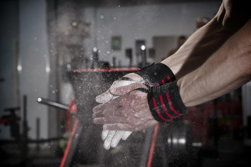 Athlete uses talc in the gym stock photos