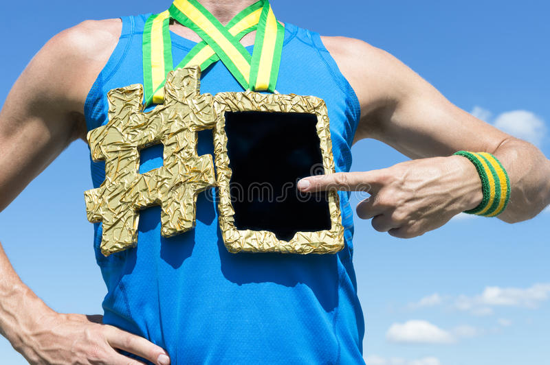Athlete Using Gold Medal Tablet Computer stock image