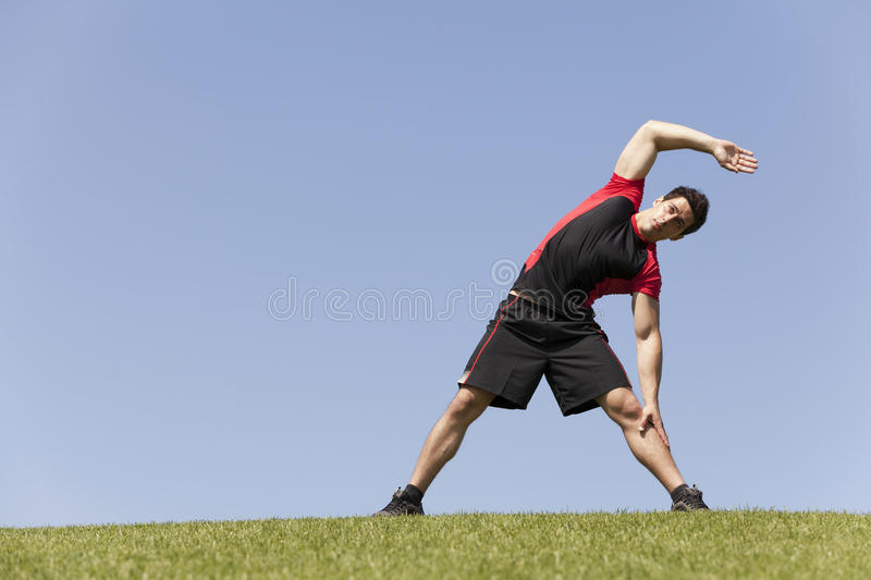Athlete warming and stretching royalty free stock images