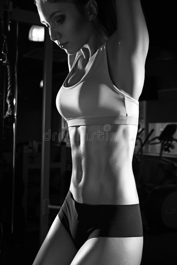 Athlete woman with perfect fitness body performing abdominal exercises royalty free stock image