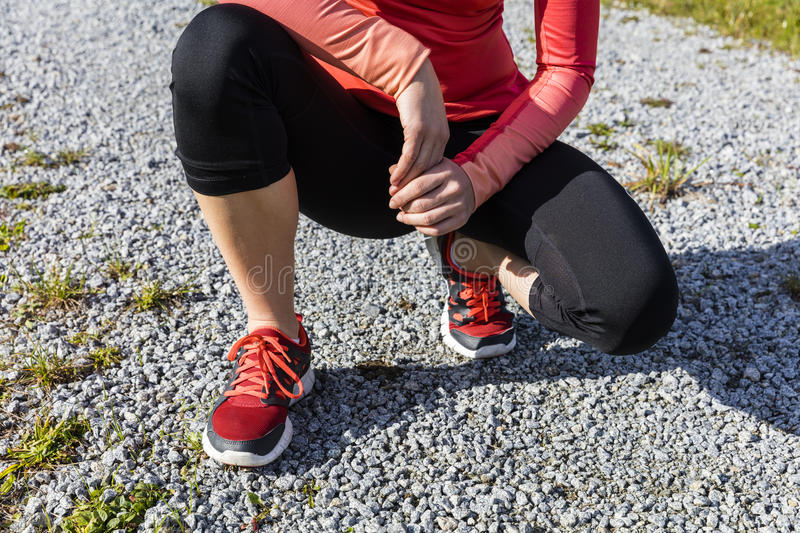 Athlete woman preparing for outdoors training, Bavarian Natio. An athlete woman preparing for outdoors training, Bavarian National Forest Park, Bavaria, Germany stock image