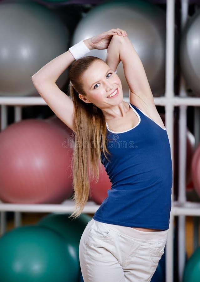 Athlete woman stretching herself