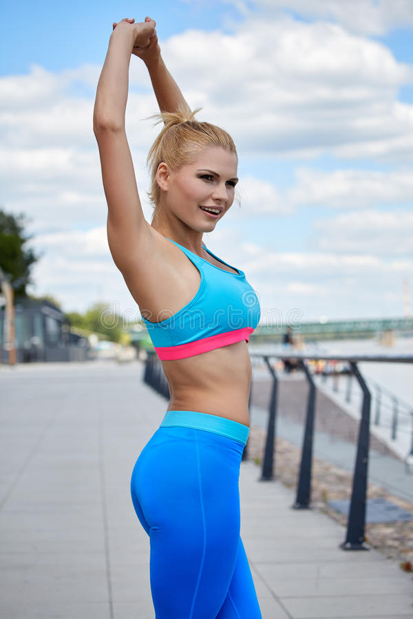 Athlete women's sportswear fit thin physique athletic build. Female athlete women's sportswear fit thin physique athletic build outdoor city river stock images