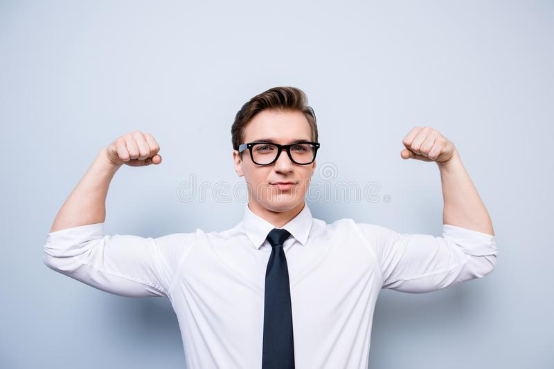 Athlete young nerdy businessman in formal wear and glasses is sh. Owing his internal strength, such muscular hands! Hot, virile, strong and mature royalty free stock images