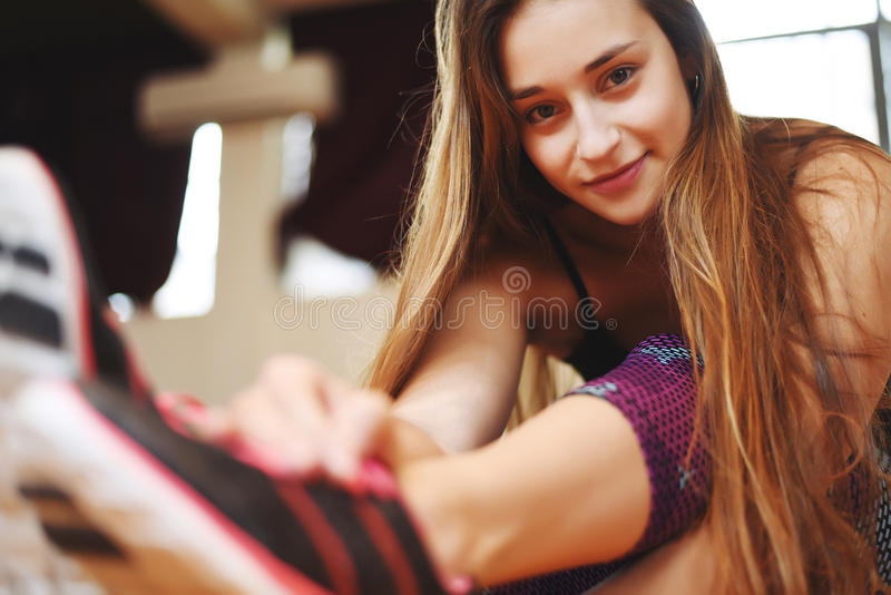 Athlete young woman doing exercise at gym. Indoors. royalty free stock photos