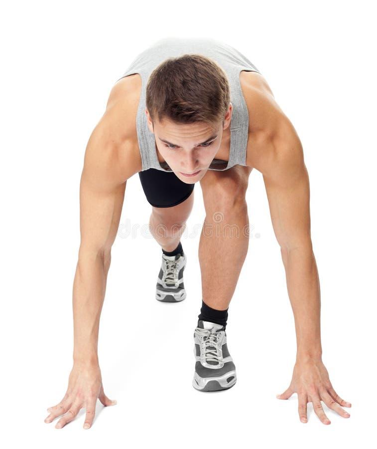 Athletenmann bereit zu laufen stockfotografie