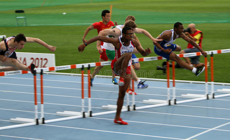 Athletes compete in the 110 meters final royalty free stock photos