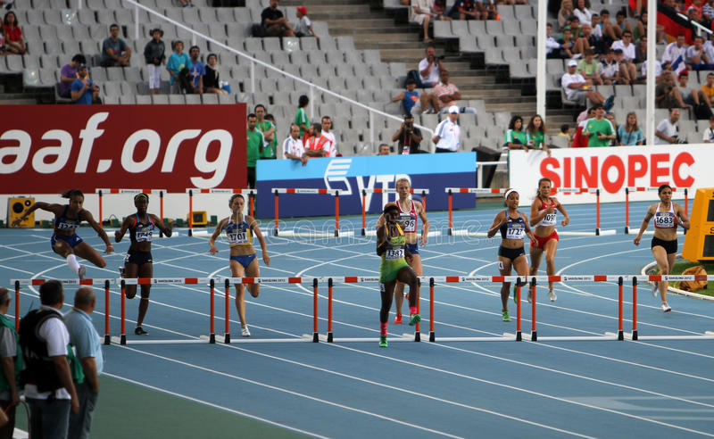 Athletes compete in the 400 meters hurdles final. On the 2012 IAAF World Junior Athletics Championships on July 14, 2012 in Barcelona, Spain stock image