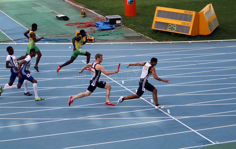 Athletes compete in the 4x100 relay race. On the 2012 IAAF World Junior Athletics Championships on July 14, 2012 in Barcelona, Spain royalty free stock image