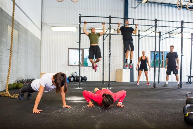Athletes Exercising In Gym stock image