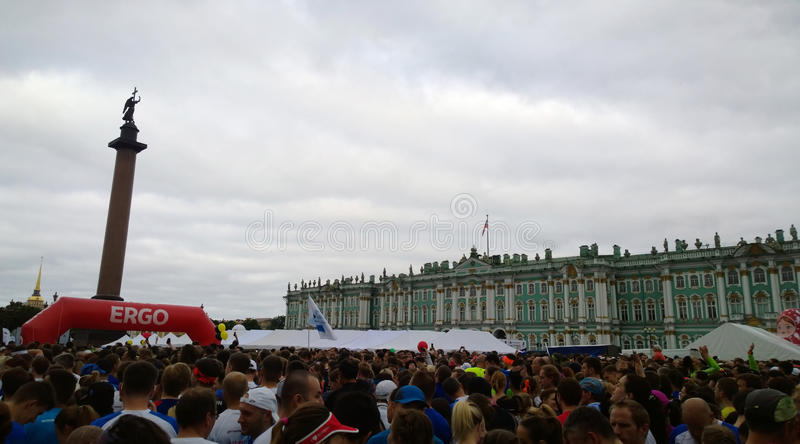 Athletes and fans in large numbers awaiting the start of the marathon `White Nights` in Saint Petersburg on Palace square royalty free stock photos