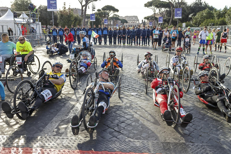 Athletes of the hand bike race at the starting royalty free stock image