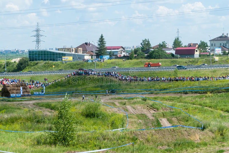 Athletes line on track after start. Tyumen. Russia. Tyumen, Russia - July 9, 2016: Steel Character extrim race on Voronino Hill. Athletes line on track after stock images