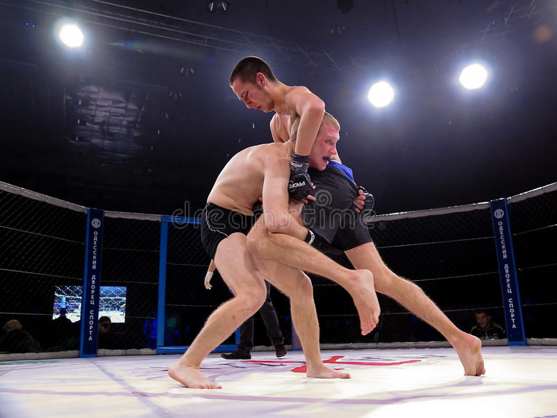 Athletes in the Octagonal ring for fights extreme Sport mixed martial arts competition tournament MMA MAXMIX. Odessa, Ukraine - 24 November 2015: Athletes in the stock image
