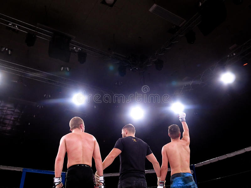 Athletes in the Octagonal ring for fights extreme Sport mixed martial arts competition tournament MMA MAXMIX. Odessa, Ukraine - 24 November 2015: Athletes in the stock photo
