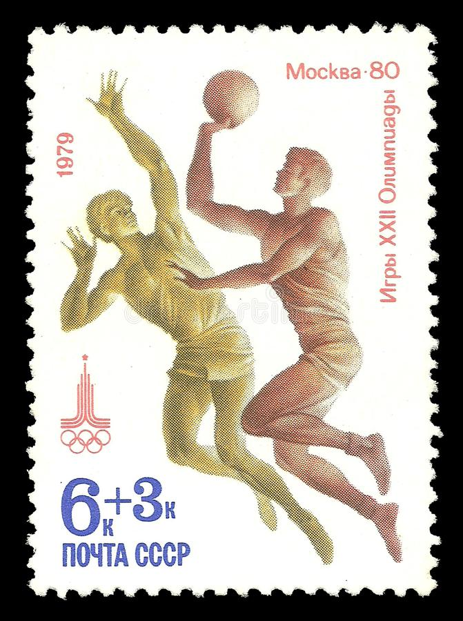 Athletes playing basketball. USSR - CIRCA 1979: Stamp printed by USSR, Multicolor edition offset printing on topic of Moscow Summer Olympic Games 1980, shows royalty free stock photography