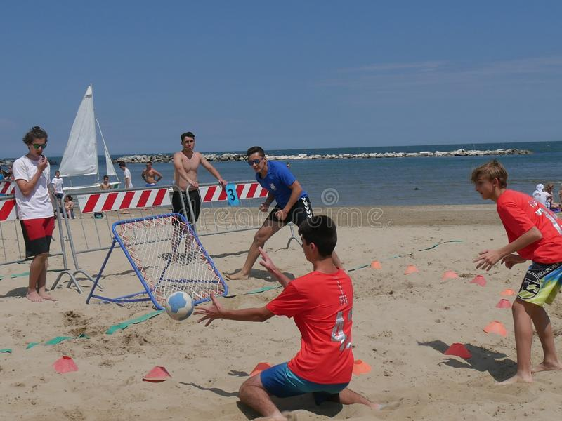 Beach TchoukBall Festival 2018 - Under. Athletes playing in Beach Tchoukball Under Tournament.nBeach TchoukBall Festival - Viserba Rimini - May 2018 royalty free stock image