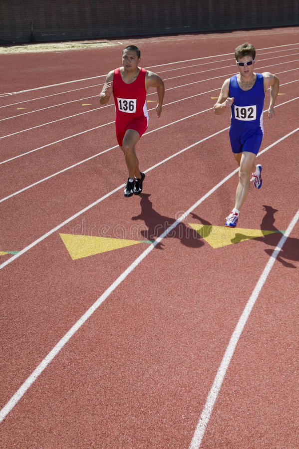 Athletes Running On Race Track Royalty Free Stock Photo