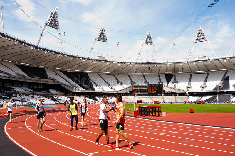 Athletes Shaking Hands In Olympic Stadium Editorial Stock Photo