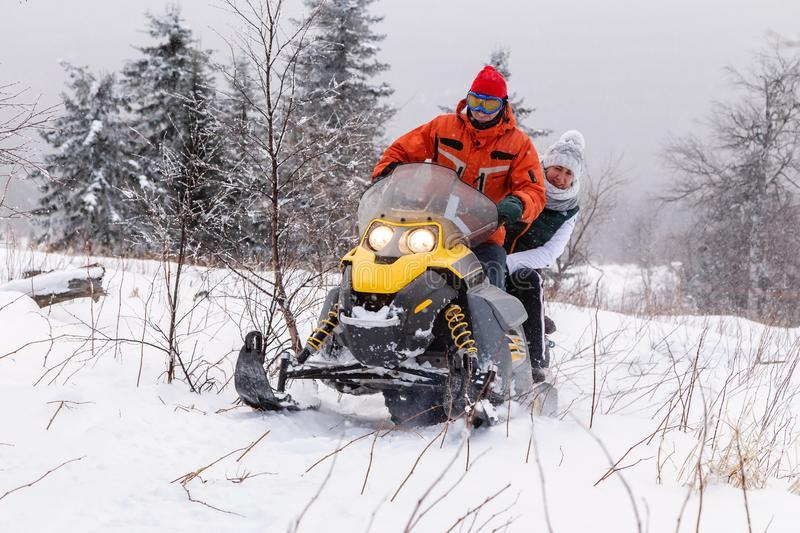 Athletes on a snowmobile royalty free stock images