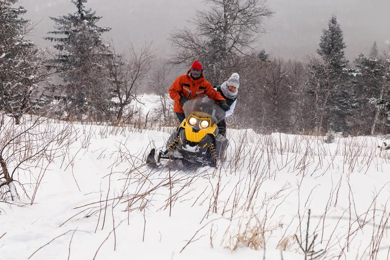Athletes on a snowmobile stock photos