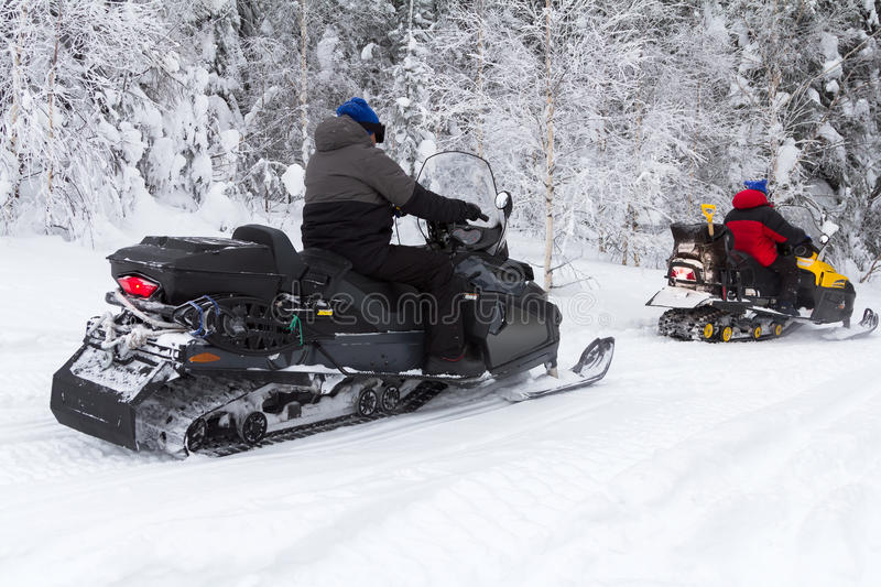 Athletes on a snowmobile stock photography