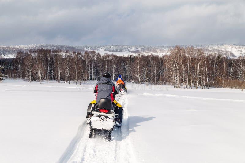 Athletes on a snowmobile stock photo