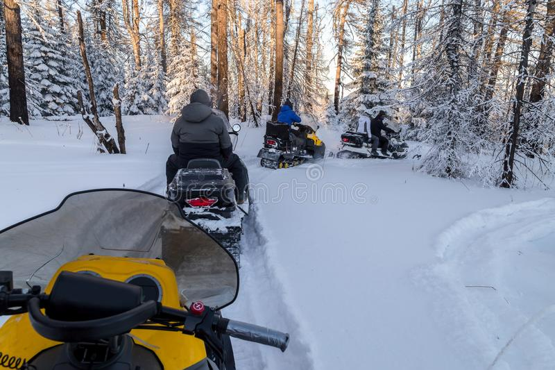 Athletes on a snowmobile. royalty free stock images