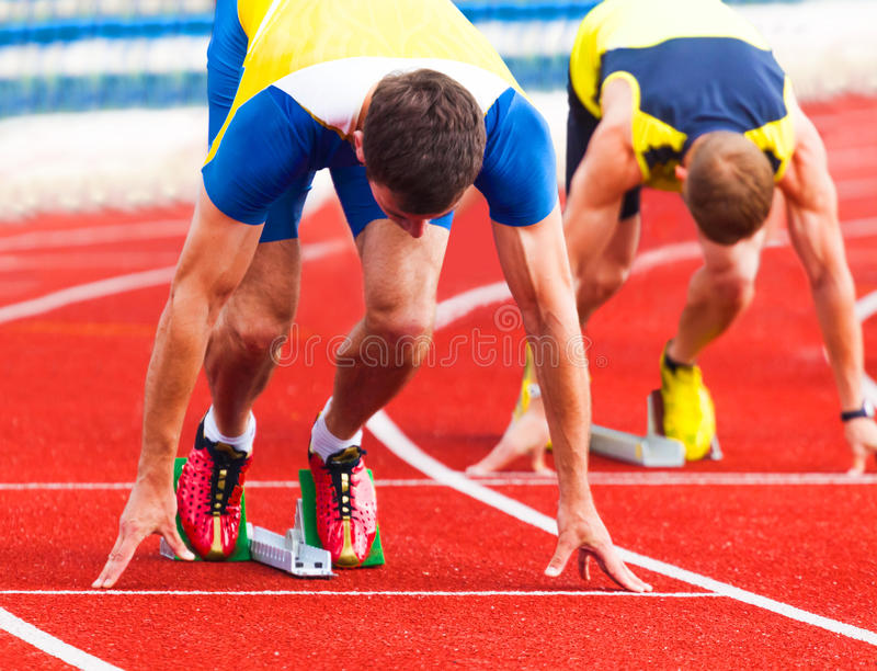 Athletes at the start stock photography