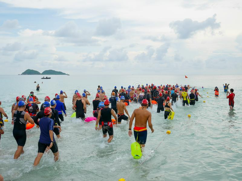 Athletes at the start of swimming race. Chonburi, Thailand - September 23, 2018: Athletes at the start of swimming race in Namsai Sport Festival 2018 stock images