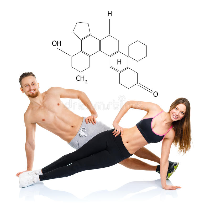 Athletic attractive couple - man and woman doing fitness exercises with the chemical formula on background - concept of healthy l stock images