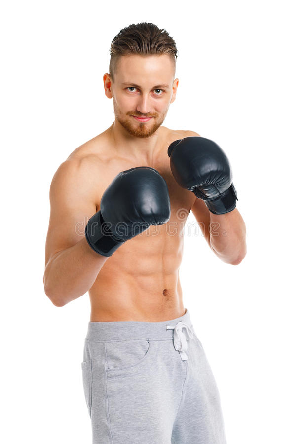Athletic attractive man wearing boxing gloves on the white stock image