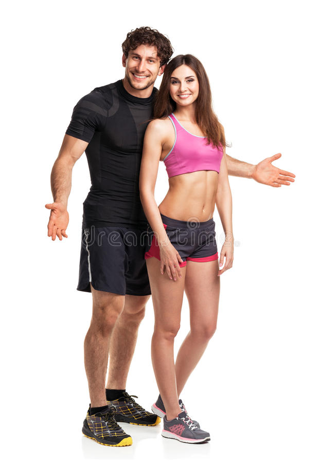 Athletic couple after fitness exercise on the white royalty free stock photos