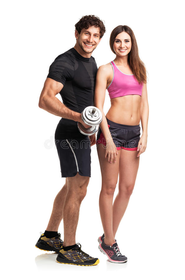 Athletic couple - man and woman with dumbbells on the white stock image