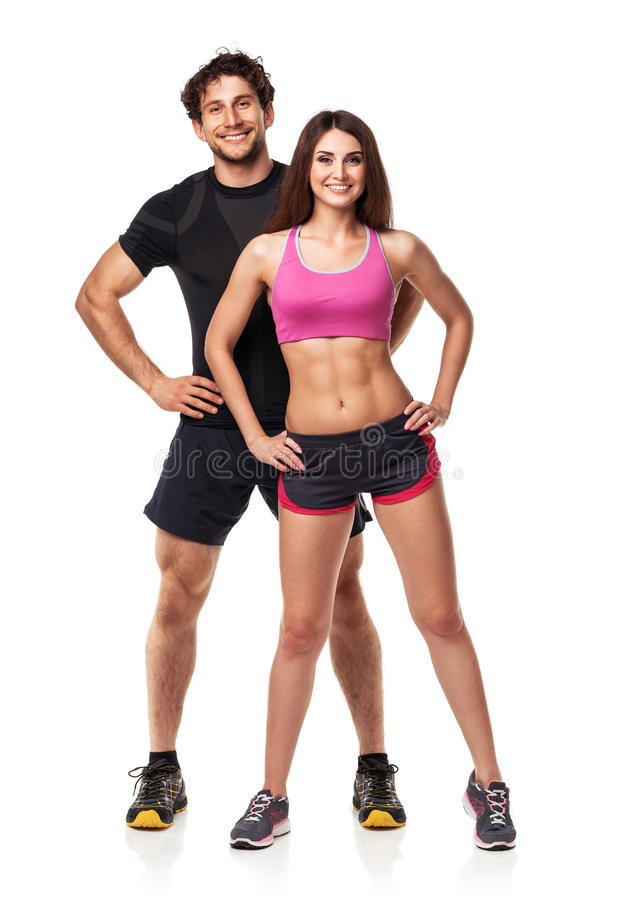 Athletic couple - man and woman after fitness exercise on white stock photo