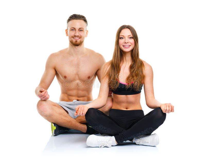 Athletic couple - man and woman practicing yoga stock photo