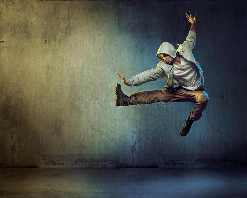 Athletic dancer in a jumping pose. Athletic dancer in a super jumping pose stock photos