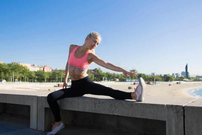 Athletic female at physical exercise outdoors royalty free stock image