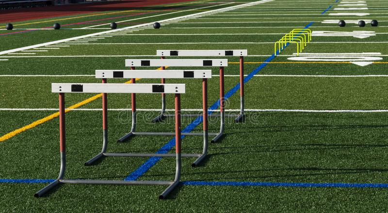 Athletic field with hurldes and medicine balls set up for practice royalty free stock photos