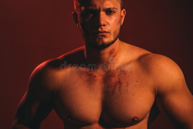 Athletic and fit. Young dirty worker man. Strong man with muscular chest. Muscular man. Construction worker or builder royalty free stock photos